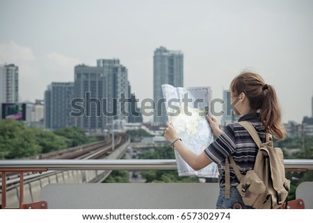 Traveler with backpack have map and compass a on train station vintage tone. travel concept #657302974
