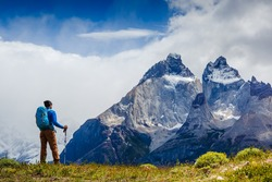 Traveler with Backpack hiking in the Mountains. Travel sport lifestyle concept. Patagonia. Chile
