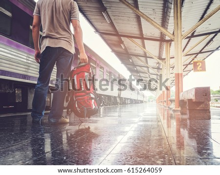 Traveler with backpack in train station. Travel concept. - Shutterstock ID 615264059