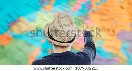 traveler with map of destinations and Trips #1079802215