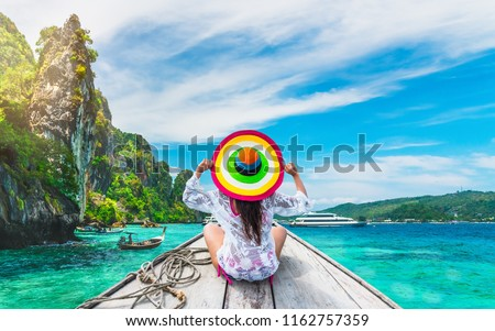 Traveler woman in beachwear relaxing outdoor lifestyle look and joy view beautiful landscape natural beach, Tourism summer holiday destination Asia, Phi Phi island Krabi, Travel Thailand vacation trip