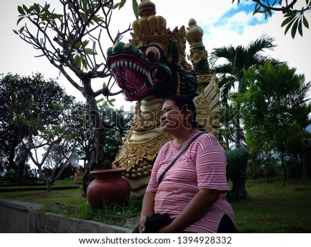 Traveler Woman In The Peaceful Garden With Big Dragon Statue At Buddhist Monastery North Bali, Indonesia