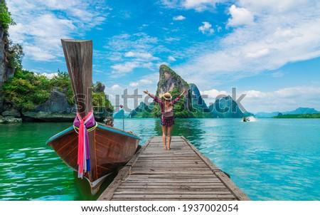 Traveler woman  joy fun beautiful nature scenic attraction landscape Phang-Nga bay, Adventure landmark travel Phuket Thailand, Tourist on summer holiday vacation trip, Tourism destination place Asia