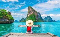 Traveler woman joy fun relaxing on wood bridge looking beautiful destination island, Phang-Nga bay, Travel adventure Thailand, Tourism natural scenic landscape Asia, Tourist on summer holiday vacation
