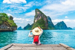 Traveler woman joy relaxing on wood bridge in beautiful destination island, Phang-Nga bay, Adventure lifestyle travel Thailand, Tourism nature landscape Asia, Tourist on summer holiday vacation trips