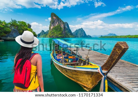 Traveler woman looking beautiful destinations place, Boat for tourist on Phang-Nga bay view Panyee island scenic nature landscape, Travel adventure Phuket Thailand, Tourism Asia holidays vacation trip #1170171334