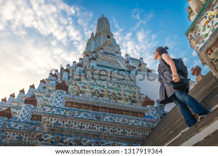 Traveler woman looking pagoda temple unique attractions in Wat Arun, Popular famous landmark travel Bangkok Thailand, Tourist female on holiday vacation trips, Tourism beautiful destination place Asia #1317919364