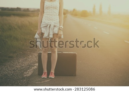 traveler woman on the road