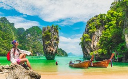 Traveler woman relaxing on beach joy nature scenic landscape James Bond Island Attraction famous landmark tourist travel Phuket Thailand summer holiday vacation trip Tourism beautiful destination Asia