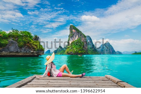Traveler woman relaxing on wood bridge looking beautiful destination island, Phang-Nga bay, Adventure landmark tourist travel Thailand summer holiday vacation, Tourism natural scenic landscape Asia #1396622954