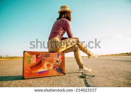 traveler woman sits on retro...