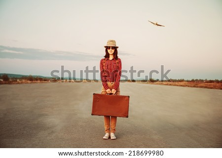 traveler woman stands on road...