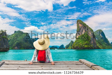Traveler woman with backpack joy relaxing and look amazed nature landscape island, Phang-Nga bay, Water travel adventure Phuket Thailand, Tourism destination Asia, Girl on summer holiday vacation trip #1126736639