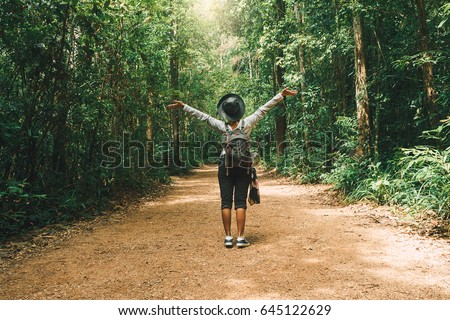 Traveler woman with backpack walking on path in the tropical forest, Krabi, Thailand #645122629
