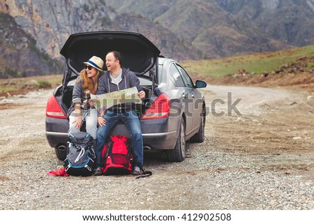 travelers by car in the...