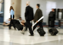 Travelers in motion rushing through an airport