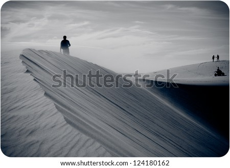 travelers in sandy dunes