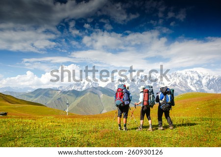 Shutterstock Travelers in the mountains. Sport lifestyle travel concept
