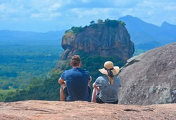 Travelers Looking Breathtaking Sigiriya Rock Fortress View From Pidurangala Rock. Pidurangala Rock Has An Amazing View Of Nearby Sigiriya, Which Looked Even More Impressive From The Height.