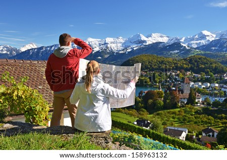 Travelers looking to the mountains. Switzerland