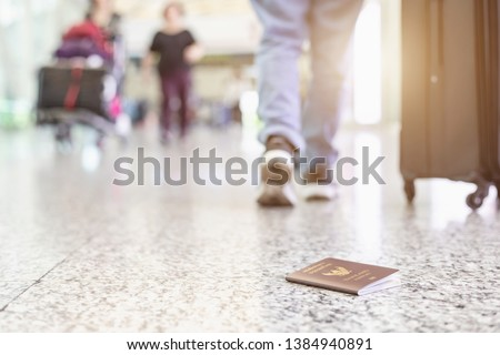 Travelers lost their Thailand passport at the airport. Losing passport while traveling concept. Focus on passport