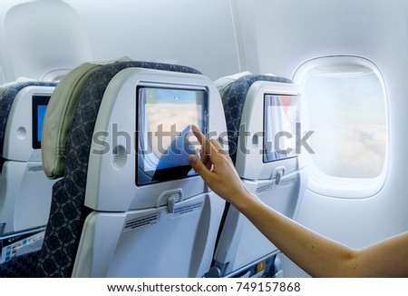 Traveling airplane and using touchscreen In-flight Entertainment