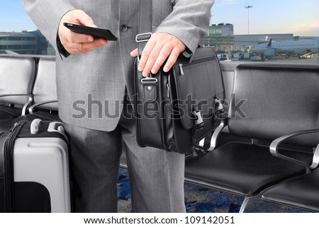 Traveling Businessman Calling by Phone at the airport