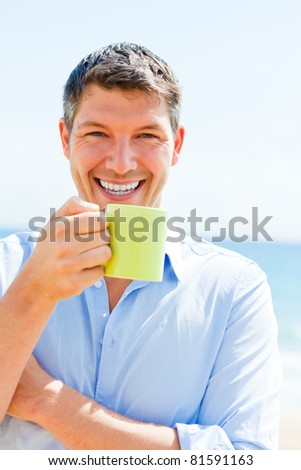 traveling businessman enjoying hotel tea and coffee on the beach
