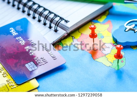 Traveling concept with credit card on map background #1297239058