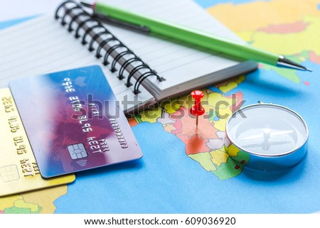Traveling concept with credit card on map background #609036920