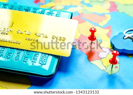 Traveling concept with passport and credit card on map #1343123132