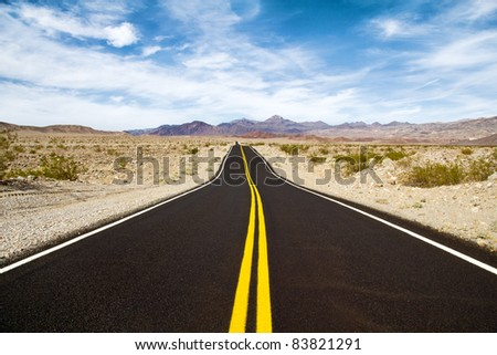 Traveling down the road in desert