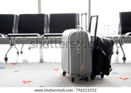 traveling luggage in airport terminal - Shutterstock ID 796221052