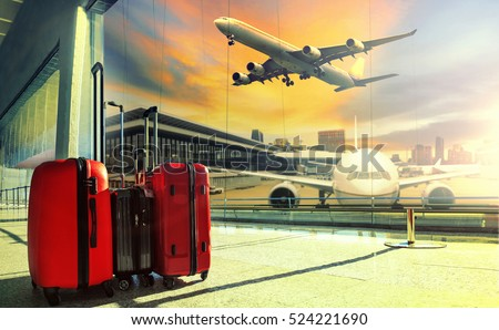 traveling luggage in airport terminal building and jet plane flying over sky