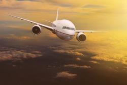 traveling plane flying over  sun rising sky