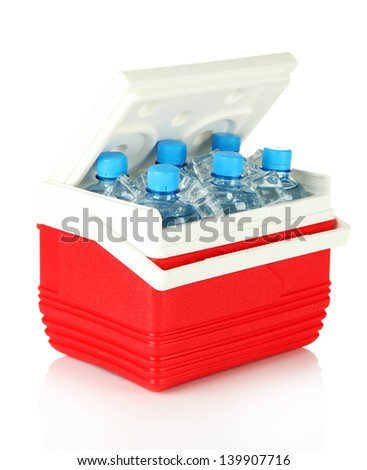 Traveling refrigerator with bottles of water and ice cubes, isolated on white