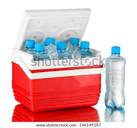 Traveling refrigerator with bottles of water and ice cubes, on grey background