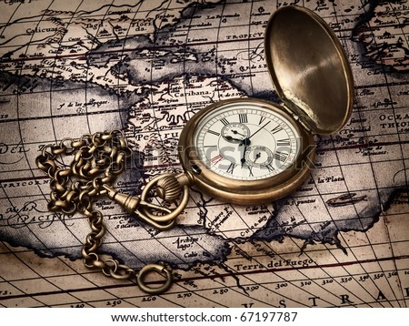 traveling theme: vintage clock at antique map