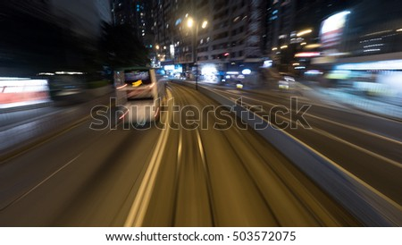 Traveling through the night city by double-decker tram. View to the rails and transport on the road. Shot in motion, Hong Kong #503572075