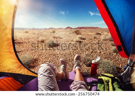 Traveling. Tourism. Tourist tent camping in desert