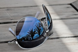 Traveller dreams concept - reflection on sunglasses