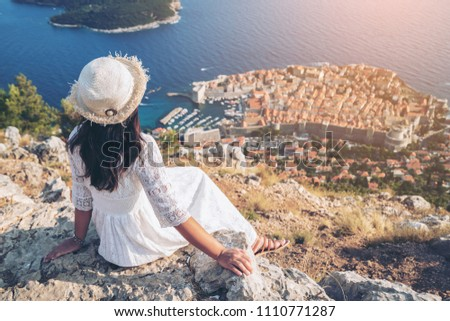 Traveller looking at view of Dubrovnik city, in Dalmatia, Croatia, the prominent travel destination of Croatia. Dubrovnik old town was listed as UNESCO World Heritage Sites in 1979. #1110771287