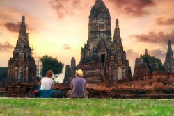Traveller travel enjoying a looking at sunset on Wat Chaiwatthanaram, travel Thailand Asia.  Traveling along Asia, active lifestyle. travel concept.