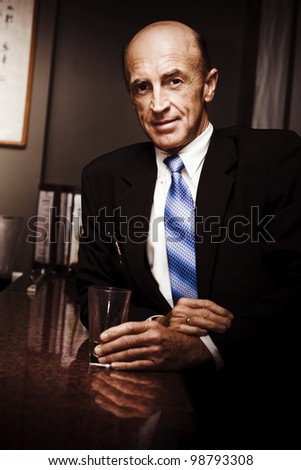 Travelling Elderly Executive Businessman Looking Pensive When Standing At A Hotel Table With Empty Glass While On A Company Business Travel Trip
