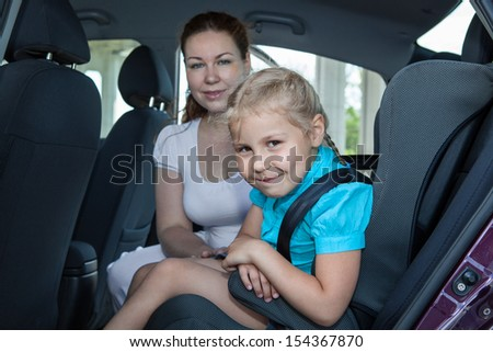 Travelling in car with safety child seat - stock photo