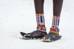 Travelling Kenya, Masai clothing and accessories details from Diani Beach Kendwa beach Zanzibar Kendwa Tanzania. Flip flops sandals of the Masai close up