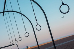 Travelling Rings for exercise at muscle beach jungle gym on in Santa Monica, California at early morning