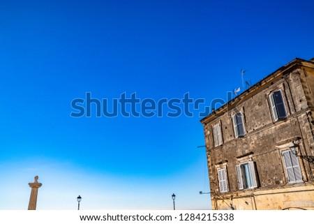 Travertine column with sculpture in memory of Giuseppe Mazzini, in the homonymous square with panoramic terrace. Ariccia, Castelli Romani, Lazio, Italy. #1284215338