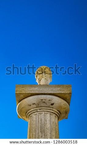 Travertine column with sculpture in memory of Giuseppe Mazzini, in the homonymous square with panoramic terrace. Ariccia, Castelli Romani, Lazio, Italy. #1286003518