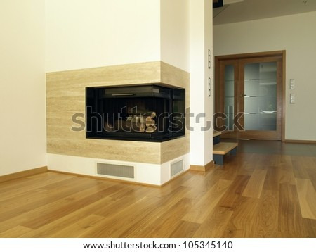 Travertine fireplace in the modern house interior